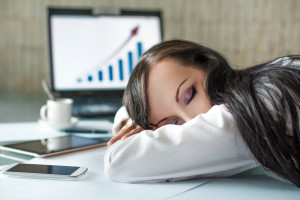 Tired shift-worker at desk during overtime
